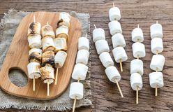 Marshmallow skewers on the wooden board Stock Photo