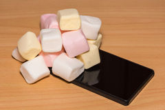 Marshmallow on a smart phone Royalty Free Stock Photos