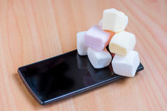 Marshmallow on a smart phone Stock Photography