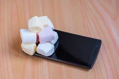 Marshmallow on a smart phone Royalty Free Stock Photography
