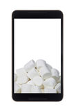 Marshmallow in smartphone Royalty Free Stock Image