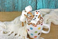 Marshmallow snowmen with hot chocolate drink Stock Photos