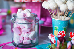 Marshmallow, sweet colored meringues, popcorn Stock Photos