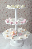 Marshmallow on a three-tiered pedestal stands on a table fuzzy p. Ink background Royalty Free Stock Photography