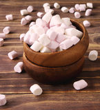 Marshmallow in wooden bowl on the table. Marshmallow in a wooden bowl on the table stock photos