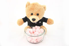 Marshmallows with bear doll in tuxedo isolated royalty free stock images
