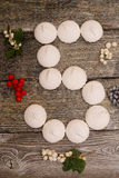 Marshmallows with berries on wooden table. number 5 Stock Photo