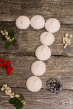 Marshmallows with berries on wooden table. number 7 Stock Photo