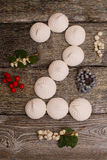 Marshmallows with berries on wooden table. number 2 Royalty Free Stock Images