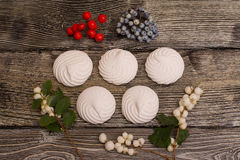 Marshmallows with berries on wooden table. the Olympic rings Royalty Free Stock Photos