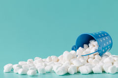 Marshmallows on blue background with copyspace. Stock Photo