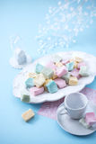 Marshmallows on a blue background, top view. Marshmallow on a plate on a blue background, vertical, close up, top view Stock Photos