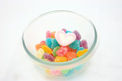 Marshmallows and candy in a bowl isolated stock photo