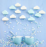 Marshmallows in cloud shapes. Snowing sugar snowflakes Royalty Free Stock Images