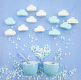 Marshmallows in cloud shapes. Snowing sugar snowflakes Stock Photography