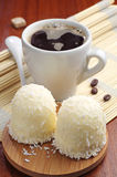 Marshmallows with coconuts and coffee. Marshmallows with desiccated coconuts and cup of coffee Stock Photos