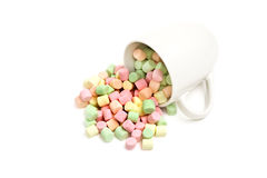 Marshmallows and cup isolated Stock Images