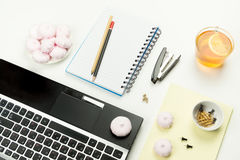 Marshmallows and Cup on the table beside the laptop, Notepad Royalty Free Stock Photography