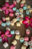Marshmallows and flowers on wooden background.  Stock Photography