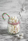 Marshmallows in a glass jar and candy Royalty Free Stock Photos