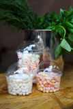 Marshmallows in glass jars on bar for sale. Desserts choice. Marshmallow chewing candies in glass jars on counter bar for sale. Traditional american sweets for Royalty Free Stock Images