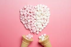 Marshmallows heart and ice-cream cones Stock Photos