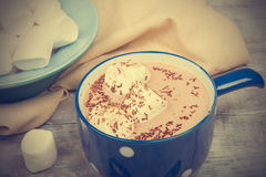 Marshmallows and hot chocolate in blue bowl. Soft toning effect Stock Photo