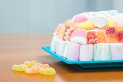 Marshmallows and jelly beans cake in pastel tones Royalty Free Stock Images