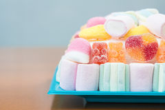 Marshmallows and jelly beans cake in pastel tones Royalty Free Stock Photo