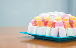 Marshmallows and jelly beans cake in pastel tones Stock Image