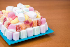 Marshmallows and jelly beans cake in pastel tones Stock Photo