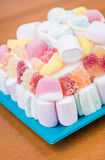 Marshmallows and jelly beans cake in pastel tones Royalty Free Stock Photos