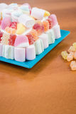 Marshmallows and jelly beans cake in pastel tones Stock Photos