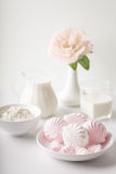 Marshmallows, milk, cheese, flower in a vase on the table. Royalty Free Stock Image
