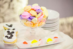 Marshmallows and other sweets on a party table. A table with a glass full of marshmallows and other sweets nearby, during a party Stock Photos