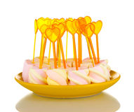 Marshmallows with skewers on plate Stock Photo