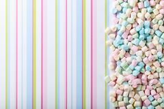 Marshmallows on a striped background . Royalty Free Stock Photo