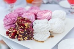 Marshmallows and turkish delights at table outdoor royalty free stock image