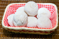 Marshmallows in wicker basket on a bamboo tray Royalty Free Stock Images