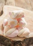 Marshmallows  on wooden background Stock Photos