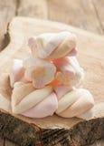 Marshmallows  on wooden background Stock Photos