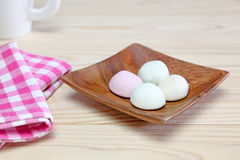 Marshmallows on a wooden plate Stock Images