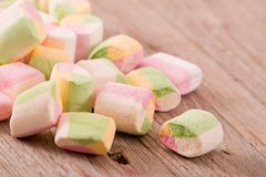 Marshmallows on wooden table. Stock Images