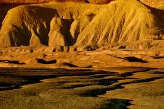 Marsinvånarelandskap i ljus av solnedgången Arkivfoto