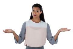 Marszczący brwi bizneswomanu wzrusza ramionami ona ramiona obraz stock