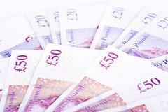 Martèle des billets de banque sur un fond blanc photo libre de droits
