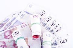 Martèle des billets de banque sur un fond blanc image stock