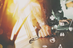 Mart medical doctor working with laptop computer and stethoscope Stock Photos