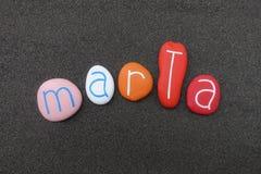 Marta, nome dado feminino com pedras coloridas fotografia de stock
