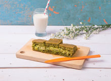 Martabak / Indonesian Sweet Giant Pancake, green tea flavour with cheddar cheese. Served with milk. On vintage background Royalty Free Stock Photo